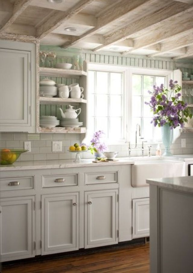 White kitchen simple and clean, love the ivory cabinets, pale sea foam paneling and the exposed beam ceiling with the rustic paint finish. Brienne cup pull and Annabelle knob in satin nickel from Bauer's Hardware COllections