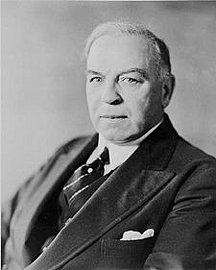 Source: Photograph Date of Origin: 1920 This photograph is showing Prime Minister William Lyon Mackenzie King, who was not happy with the debt the country had. He used all this time to figure out how the country was going to pay its' debts and so he had to start from somewhere. The 1920s was not roaring because as everyone was partying and drinking, he was sitting in his office, trying to pay the country debt.