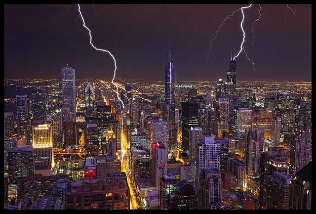 Chicago Lightning. We hit a great storm while we were up in the Hancock Observatory. You should have seen how excited we were while this storm was happening. There is actually 3 lightning bolts in the scene. One hitting Sears (Willis) Tower to the right, the bolt to the left of Trump Tower, and if you noticed that all the buildings looked a weird color, that's because a lightning bolt was hitting our tower as well. It sure was a spectacular show!