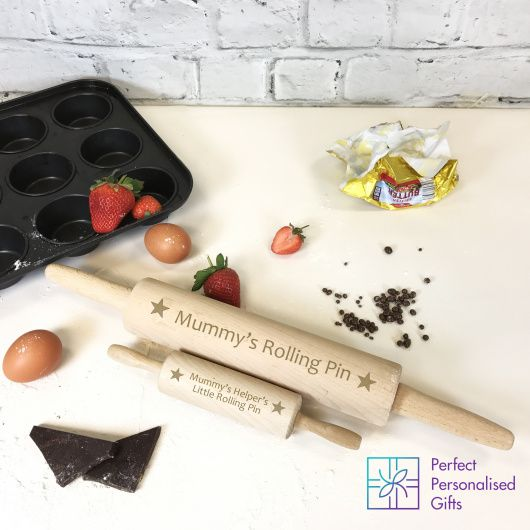 Mummy's Helper Rolling Pin Set.  These parent and child personalised rolling pins make a unique gift for anybody who loves to bake with their children.  Great alternative present for any gift occasion where the family members are keen bakers.  These beautifully engraved rolling pins are so cute and perfect for a gift for a Mum, Dad or Grandparent who enjoys to bake with a little helper.   We are happy to work wih you if you would like a different design or wording, please just contact us.