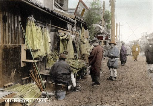 Kobe, 1906. New Year Celebrations. A booth selling ropes made of rice straw used to decorate the entrance way. This image is part of The New Year in Japan, a book published by Kobe-based photographer Kozaburo Tamamura in 1906.