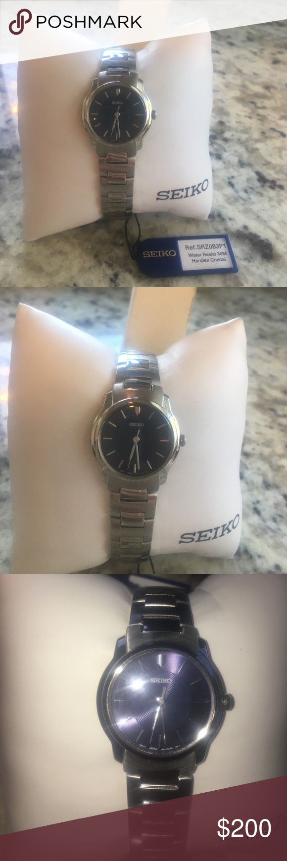 NWT Seiko Ladies Stainless Steel Watch NWT Seiko Ladies Watch.  Hardlex Crystal with a dark navy face Stainless steel, water resistant  Japanese Quartz movement  Never worn, new with tags!  Needs new battery  Matching Men's  Watch, willing to sell as a pair! Seiko Accessories Watches