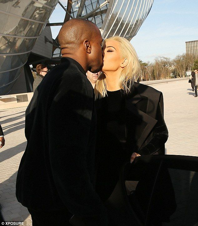 Kiss me quick! Kim stopped for a moment to engage in a passionate smooch with her man at the Louis Vuitton Foundation