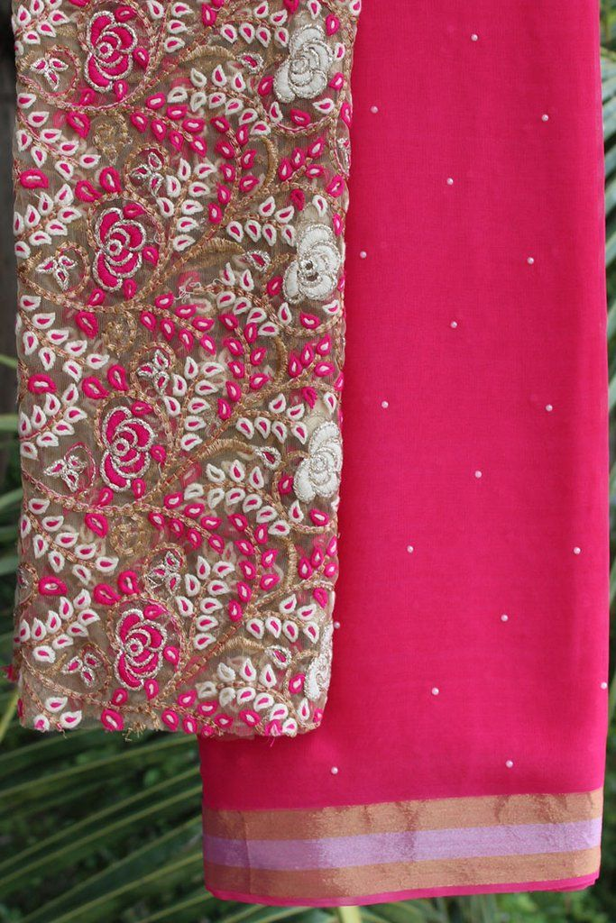 Hot pink georgette saree with embroidered blouse piece