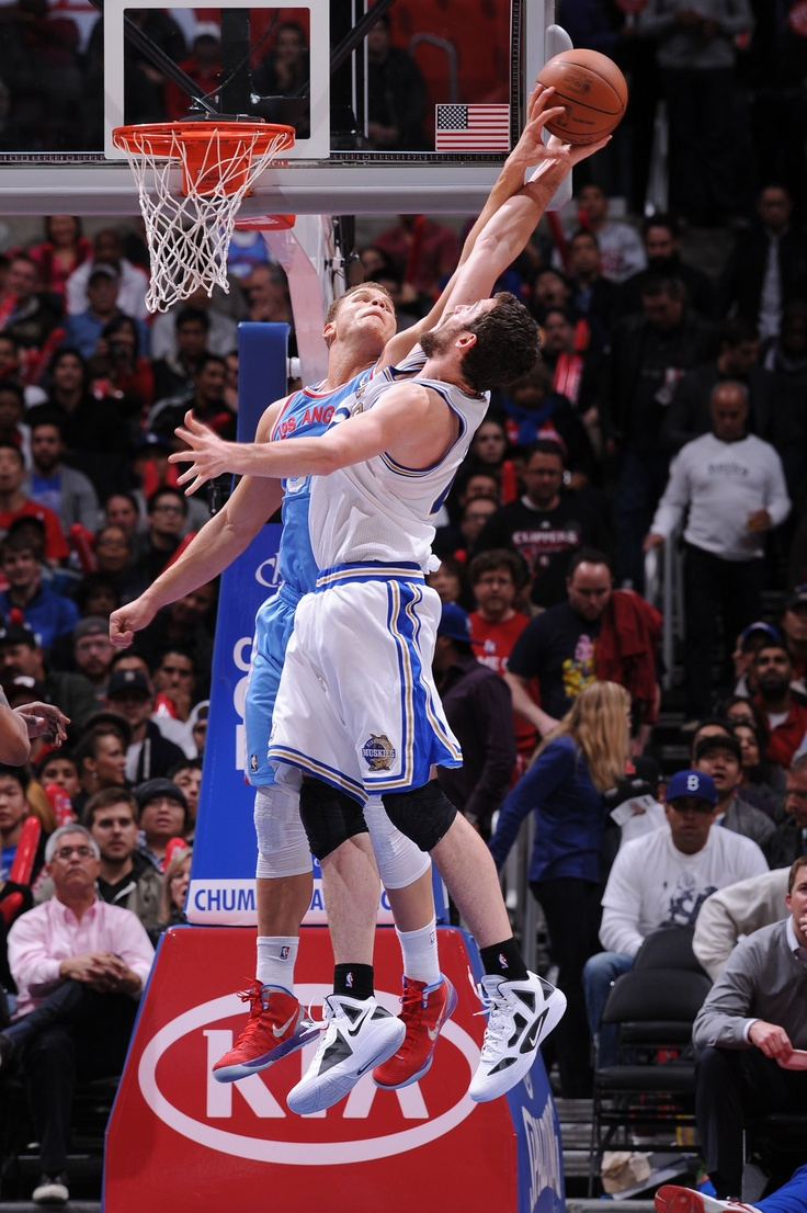 Blake Griffin (Los Angeles Clippers) turning away a Kevin Love (Minnesota Timberwolves) layup
