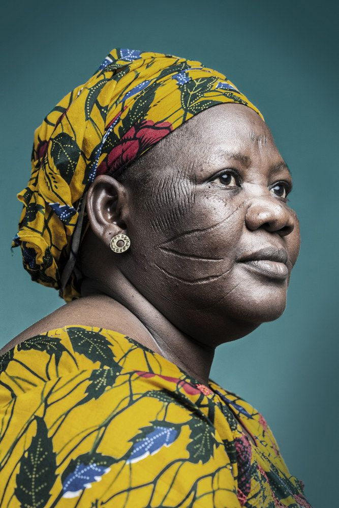 """13 Powerful Portraits Of Africa's Scarred Faces - Found via Buzzfeed - """"Joana Choumali's stunning photo series """"The Last Generation"""" captures the social practice of scarification in Africa – the act of scarring one's face as a cultural tradition. Scarification is a permanent body decoration with ancient origins; it's considered a ritual of passage to adulthood and a statement of belonging."""""""