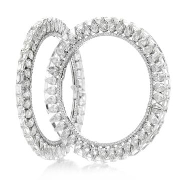 A Pair of Diamond Bangles,by Viren Bhagat amazing the way the emerald cut are set!
