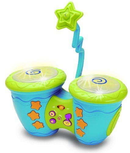 """Sing Along Electronic Bongos with Microphone and Scratch Discs Learning & Exploration Toy by Ottavo by OTTAVO. $25.99. 2 Light Up Drum Pads, 2 Scratch Discs to Make Fun Sounds. Detachable Sing Along Microphone. 4 Samba Style Musics, 6 Sound Effects Jam in. Scratch the Discs and Hit the Pads. Operate with 3 """"AA"""" Batteries included. Does your child have a knack for music? """"Sing-Along Electric Bongos"""" is perfect for the budding salsa musician/bongo-player within! With six different..."""