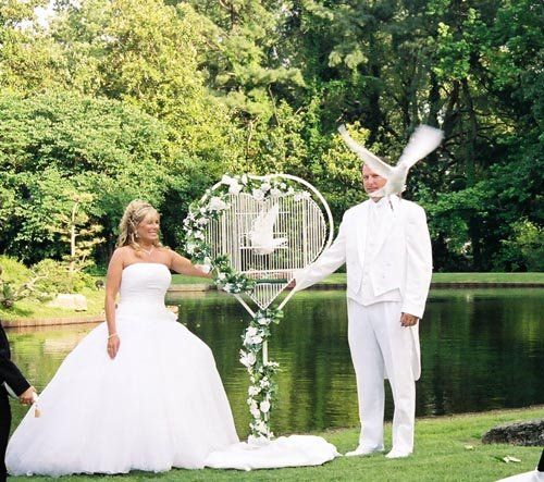 """The """"Unity Dove"""" heart shaped cage.  The couple releases their doves to fly away together during the unity song or at the end of the ceremony."""
