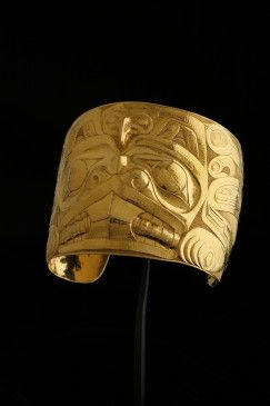 Gold bracelet repousséd and engraved with Haida Beaver and Eagle design
