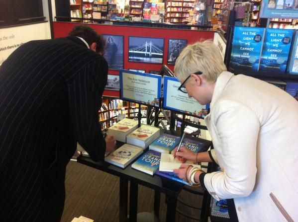 Antoine and Caroline signing stock at Waterstone's King's Road