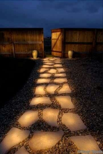 """Line a pathway with rocks painted in glow in the dark paint. (Make sure they are first painted white) During the day they """"charge"""" in the sun and in the evening they reflect the stored light."""