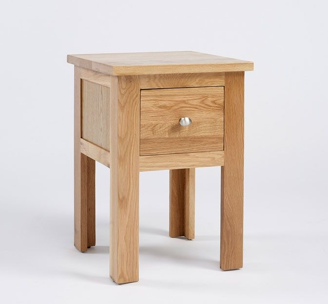 The Lansdown Oak 1 Drawer Lamp Table is a slim and elegant product crafted from a high quality, light oak. This is a robust and long-lasting lamp table finished with a satin lacquer finish which protects against wear and tear. This light oak piece displays unique grain patterns which are highlighted by the soft sheen patina and each leg end has a floor protector underneath. This piece has a compact drawer at the top, which is crafted using dovetailed joints, giving it a sturdy structure…
