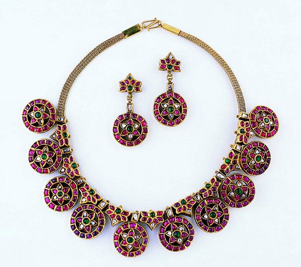 Gold necklace and earrings set with diamonds, rubies, and emeralds South India; 19th century