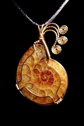 Ammonite Fossil Cabochon Handmade Wire Wrapped in Bronze Pendant via Etsy.