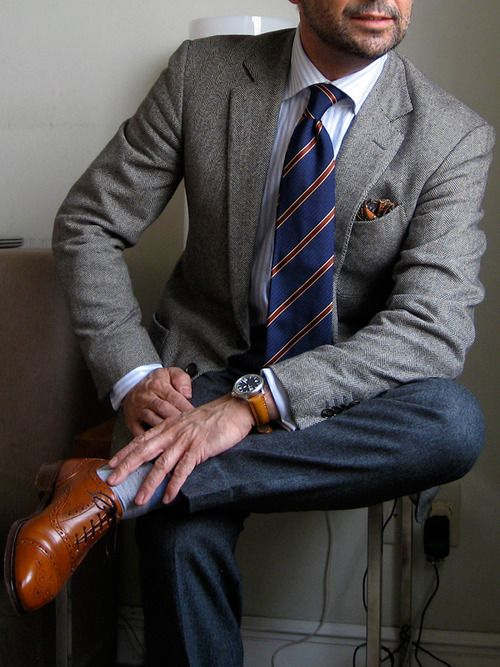 Classic repp striped tie paired with sport coat and pocket square.
