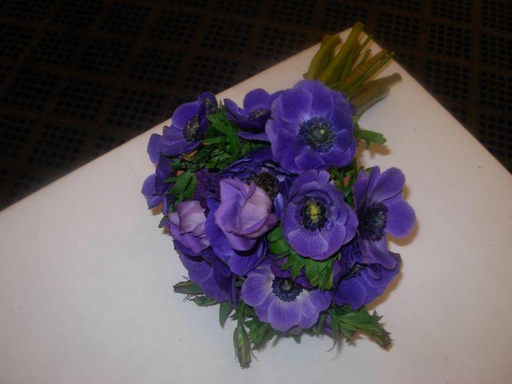 Purple anemone hand tied informal bouquet