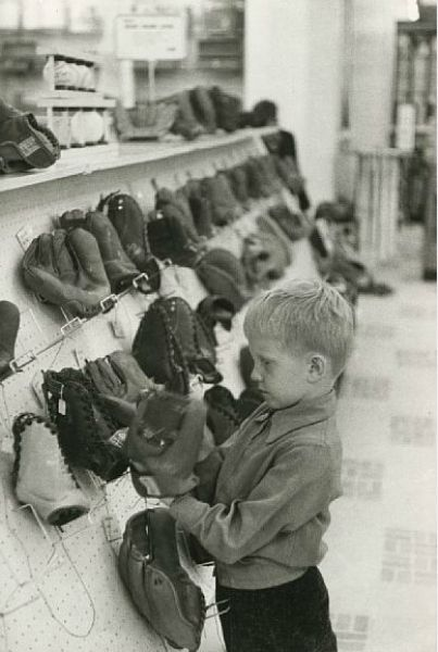 Picking out a new baseball glove...by Henri Cartier Bresson
