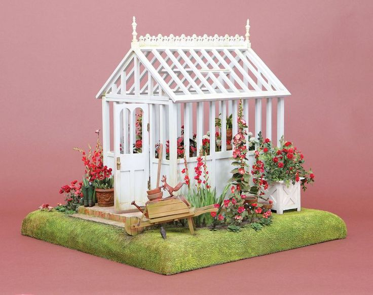 English Green House by Polly Morris, right side. Project started with a purchased Marjolein Bastin greenhouse from Hallmark. I added the brick foundation, steps, floor and roof ornaments, as well as the landscaping. The flowers and plants were made from painted paper and manilla folders. I also used Pepperwood printies. The lawn was made from an old Velux blanket, carefully painted. I made the English squirrel, robins,  black birds, Wellington boots and hose from Promat clay, my favorite.