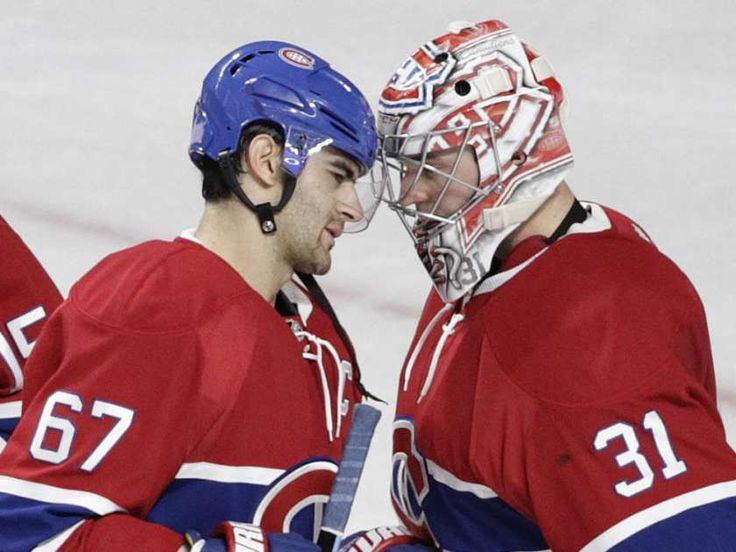Goalie Carey Price (left) and captain Max Pacioretty of the Montreal Canadiens celebrate the team's victory against the Toronto Maple Leafs in an NHL game at the Bell Centre in Montreal on Saturday, October 24, 2015, in Montreal.