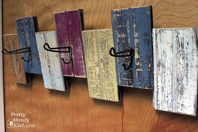 Old board pieces, cut, painted and turned into a coat rack.