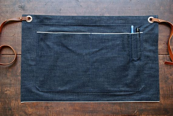 Our half apron, updated! This denim apron is your choice to get the job done with ease. Turn up the level in the bar, restaurant, workshop, coffee shop, etc. Sourced from Cone Mills White Oak plant here in the USA, this hefty 12 oz. selvedge denim will help protect your clothes against wood and metal shavings, ink, lattes, paint, coffee grinds, dye, or whatever else one may be getting into. And now that weve made the leather straps removable, the denim can be washed (though we recommend…