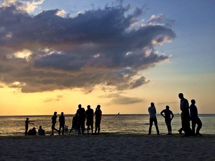 Sunset overlooking a football beach game. #zanzibar #beach #sunset #football #sea #ocean #teams #stonetown #sandy #beachfootball
