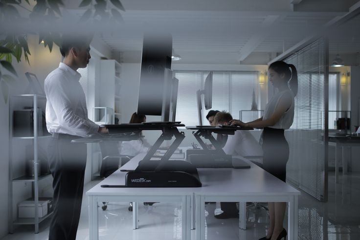 Office workers often stand up in unison so they can chat while working easily - http://uk.varidesk.com/varidesk-single - #standupdesk