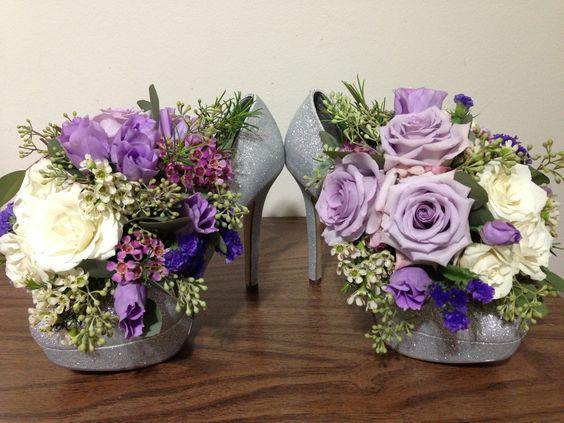 Shoe centerpiece idea > high heel floral arrangement. Fun & unique!
