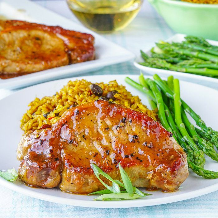 Honey Ginger Dijon Glazed Pork Chops. A super simple glaze, gets brushed repeatedly onto these perfectly grilled, juicy chops in one of the easiest & most flavourful pork chop recipes you'll ever try.