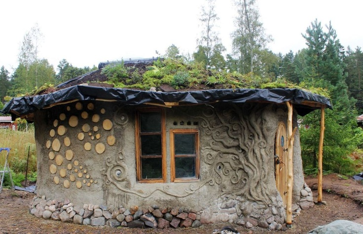 Cob & Cordwood Cottage in Finland,  Heidi Vilkman's cob and cordwood cottage in southern Finland. Beautiful flowing motifs in the walls, a living roof, whimsy and artistry everywhere you look.