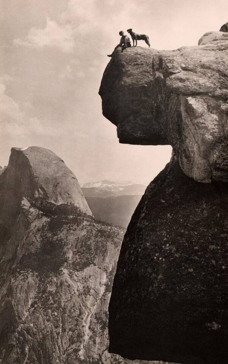 A man and his dog on the Overhanging Rock in Yosemite National Park 1924