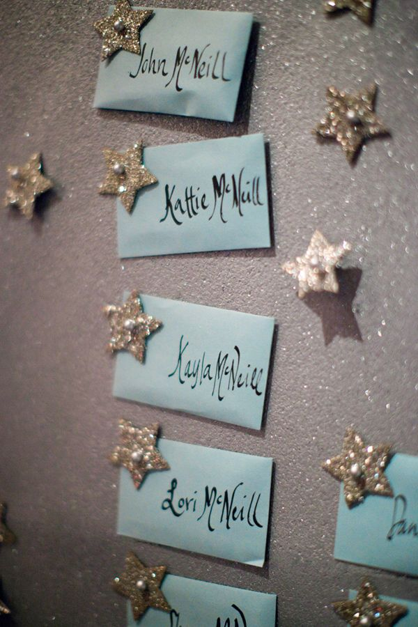 escort cards pinned with glitter stars // photo by Sonya Yruel