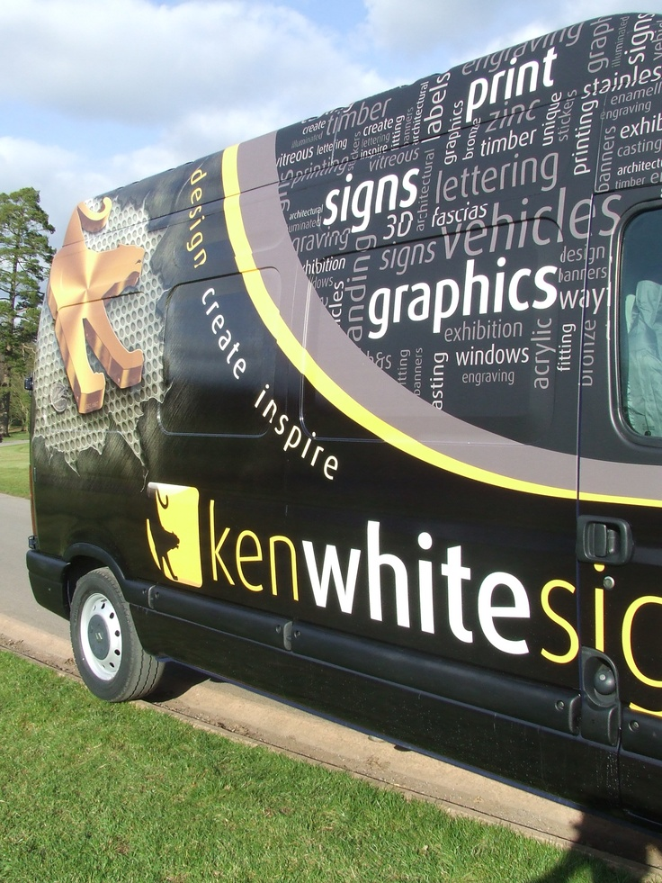 Close up side profile of the vehicle wrap we applied to our own vehicle.  This vehicle was previously blue but has been completely covered with our new corporate branding