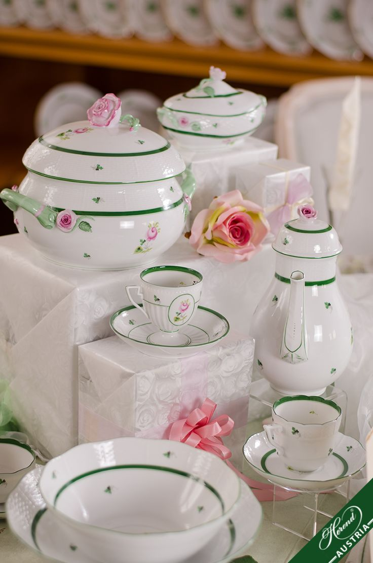 "The charm and modesty of the "" Old Rose of Herend "" have kept it popular to the present day. This Décor possible to order instead of green with gilded rim.  http://www.herend.at/services/vienna-rose-vrh-herend-porcelain-sets/"
