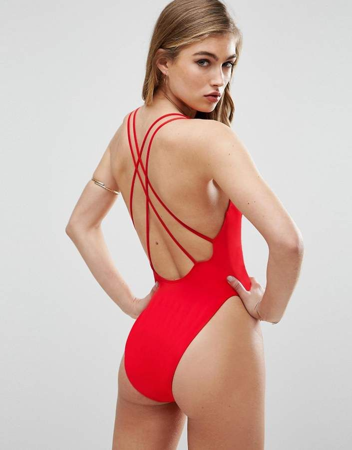 40e9299449d ASOS Cross Back High Leg Swimsuit PRODUCT DETAILS Swimsuit by ASOS  Collection Sustainable fabric made with recycled yarn Plain swim fabric  V-neck Crossover ...