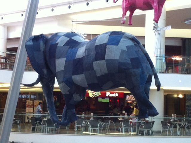Massive elephant made of Shweshwe suspended above the food court. Using hand made decorations aids economic empowerment in the Western Cape.
