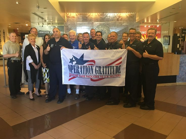 "Scottsdale Police Department: ""We were lucky enough to have Jack Knight from Operation Gratitude visit us at the Police/Fire Headquarters today. Jack shared his message of Operation Gratitude with us and expressed his thanks for what we do through a song written by him."""