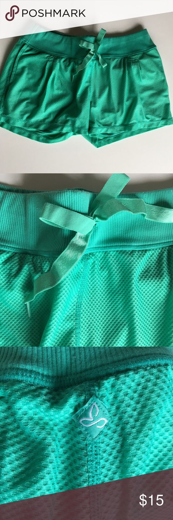 PrAna Teal shorts Size M PrAna Teal shorts Size M Lined with spandex shorts (as shown in picture) Super comfortable! Pre-owed, great condition If you need additional pictures or measurements please feel free to ask! 😊 Prana Shorts