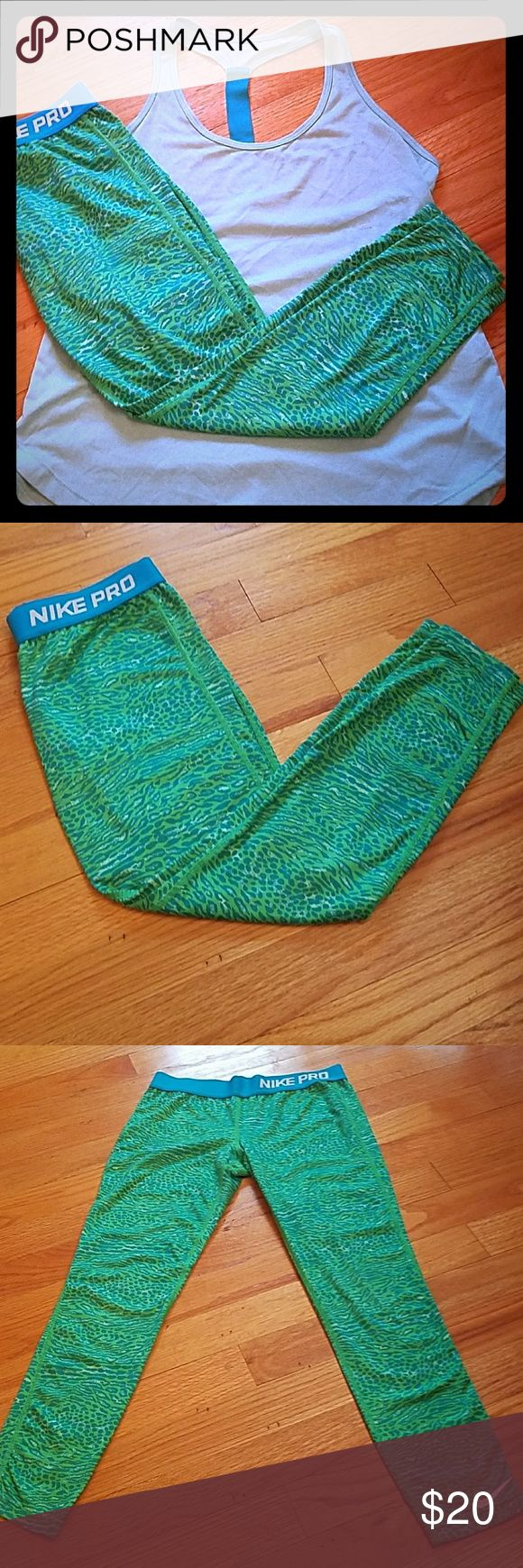 Nike Pro Capris Size Medium Medium pair of Nike Pro Capris. Blue and green animal print. Blue waist band.  Great for the gym or to lounge around in.  Make me an offer !!!! Nike Pants Leggings