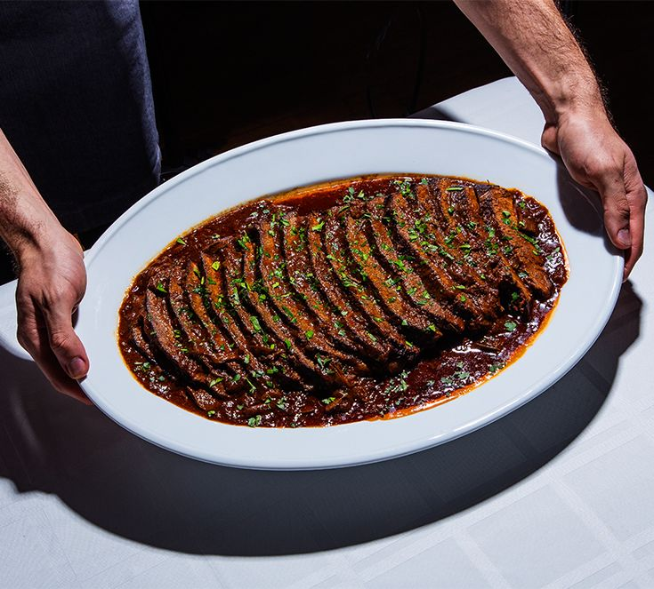 This rich braise of brisket in a tomato and wine sauce is the perfect ...