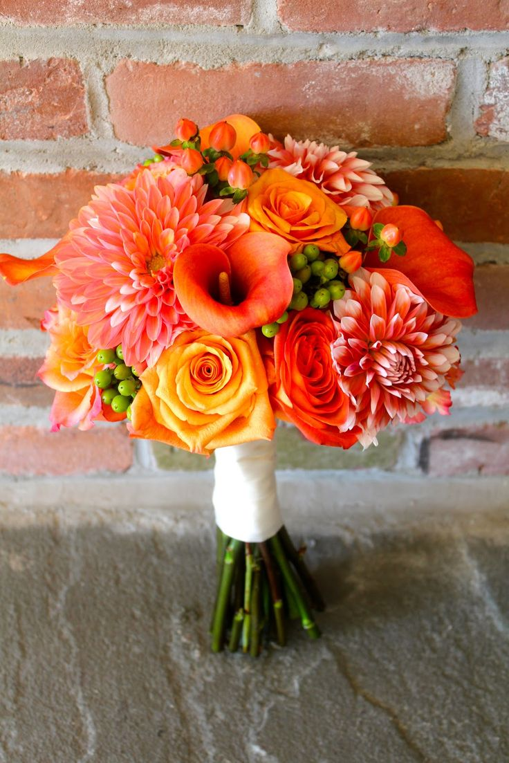 colors for an early october wedding | The bride carried an orange and coral bouquet of dahlias, calla lilies ...