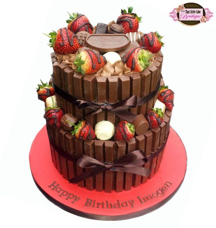 Vanilla Sponge, Chocolate Buttercream, Dark Chocolate Ganache, Lots of Kit Kats, Thorntons Chocolate and Chocolate Covered Strawberries. Heaven…right?!