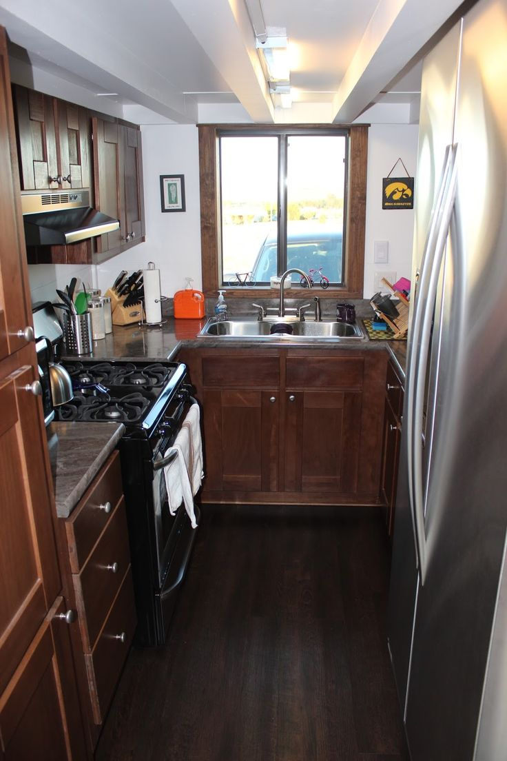 The Morrison: a 300 sq ft tiny house with two bedrooms, a full kitchen, bathroom, and a living room. It's currently available for sale in Spearhead, SD,