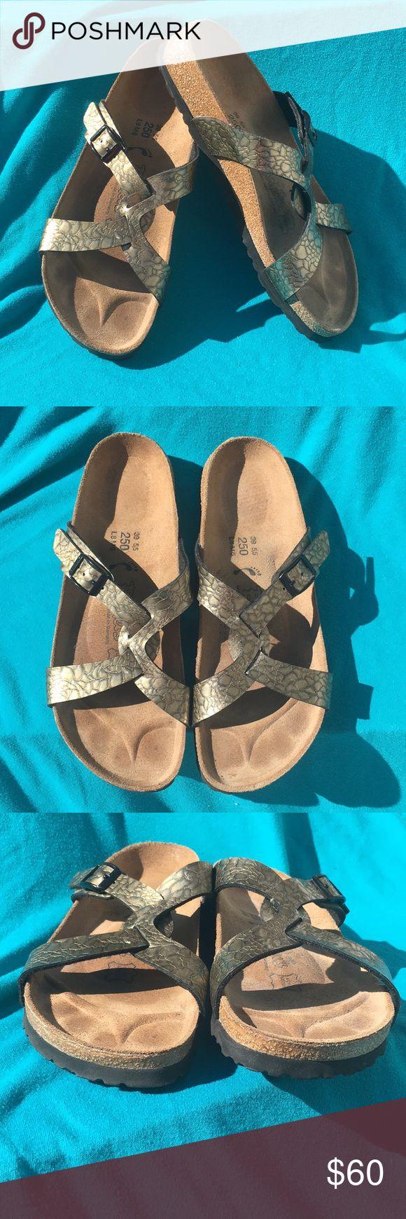 Birkenstock Sandals Ladies size 8 Men's size 6 EUC - Birkenstock Sandals. Gold design on strap. Ladies size 8 men size 6. Fits an 8.0-8.5 by Birkenstock sizing chart (euro size 39 on Birkenstock sizing). Birkenstock Shoes
