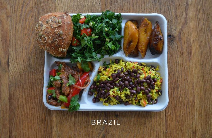 Provided by The Huffington Post School lunch from Brazil - Pork with mixed veggies, black beans and rice, salad, bread and baked plantains.