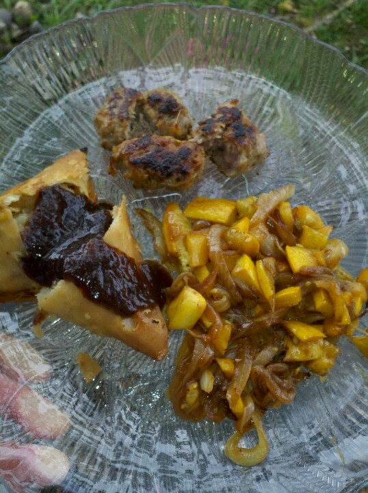 Samosa with tamarind chutney,caramelized golden zucchini and onion,and sausage.