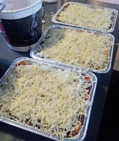 Lasagna 1 lb. Ground beef 1 medium Onion, chopped ½ tsp. Salt 1/8 tsp. Garlic powder 1 Jar 15 ½ oz. Spaghetti Sauce (I use traditional Ragu) 1 pint Cottage Cheese ¼ cup grated Parmesan cheese 2 Tbsp. dried Parsley 4 oz. Lasagna Noodles, cooked to al dente and cooled in cold water 12 oz. shredded Mozzarella Cheese ( about 1 ½ cups)