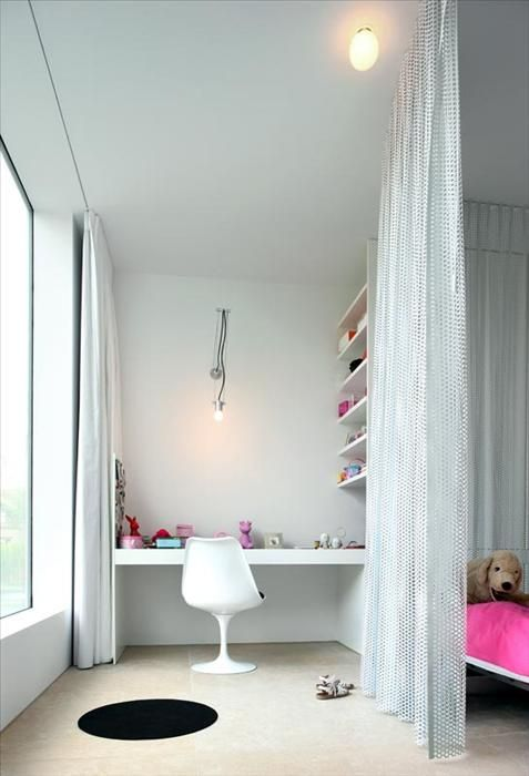 A functional workspace for kids! We love how the floor-to-ceiling curtain divides work area and living area. #modernalways #saarinen
