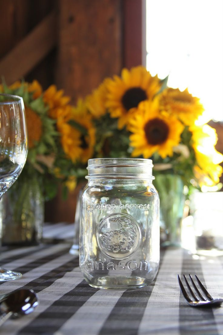 rustic table decor with sunflowers and mason jars | Here is the view from the tables… the whole side of the barn is wide ...